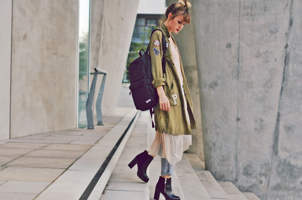side view, olive parka, patches, tulle skirt, black boots, rucksack