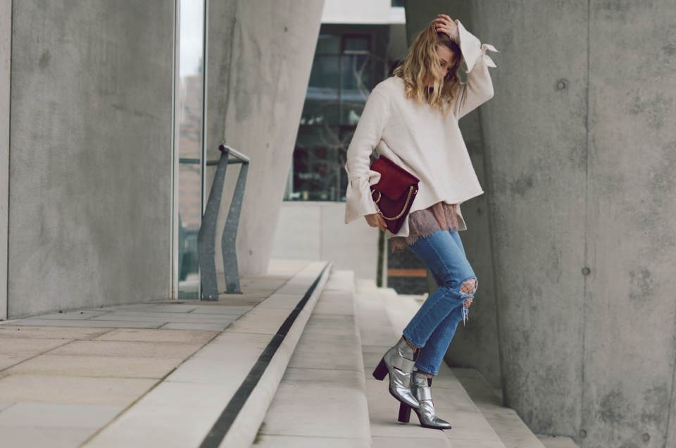 white sweater, wool, jeans, boots, red bag