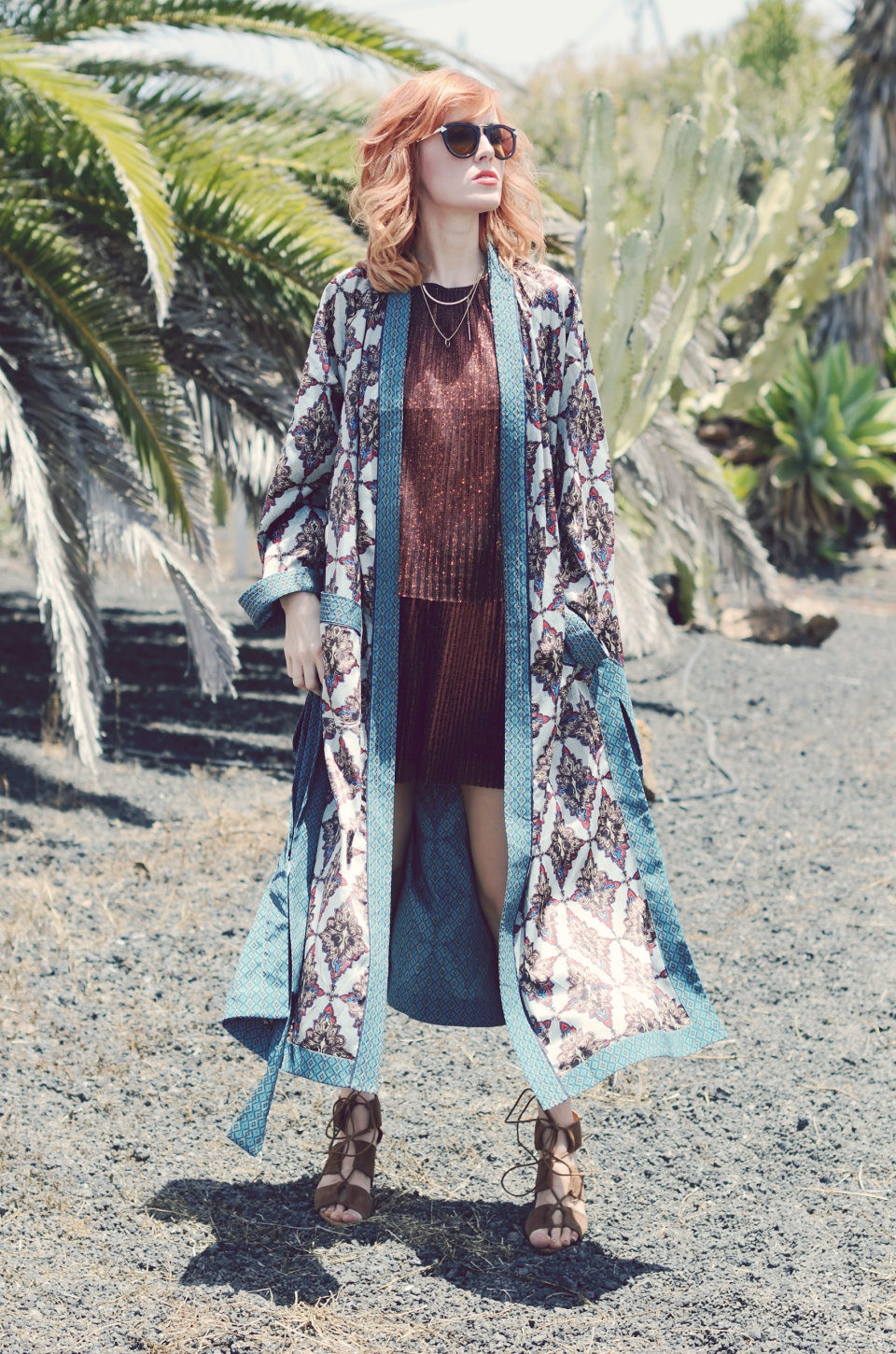 kimono style coat, turquoise, red two piece suit, sunglasses
