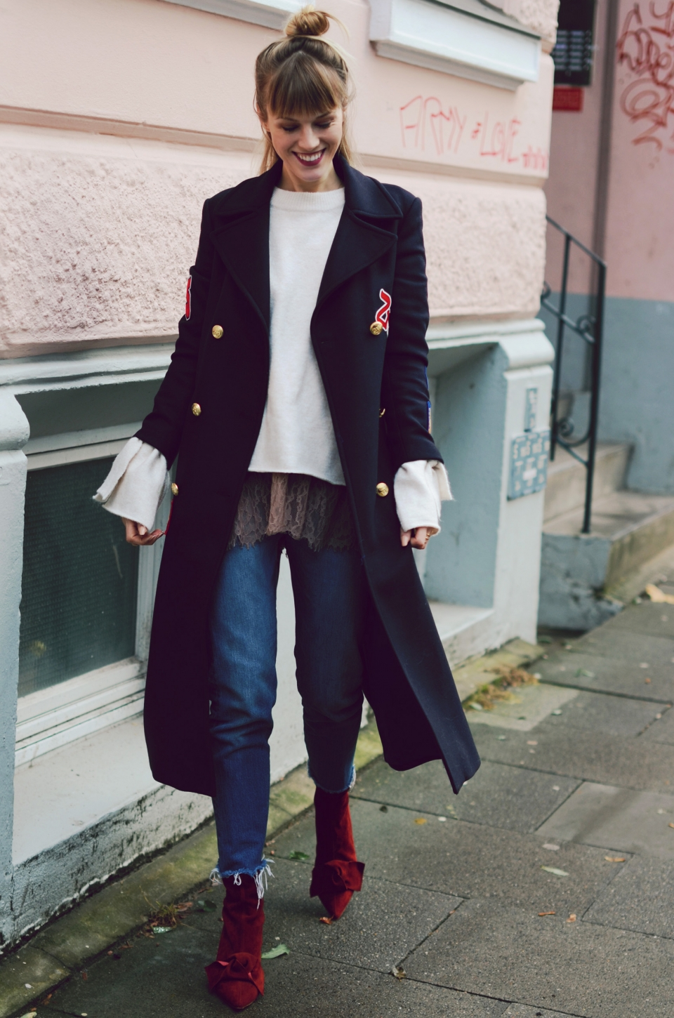 Long dark blue coat, red suede boots, knitted sweater