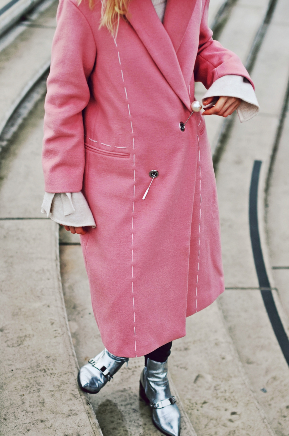 closeup long pink winter coat, metallic boots, silver, white pullover