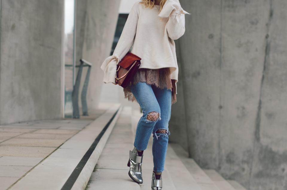 red handbag, jeans, metallic boots, white sweater