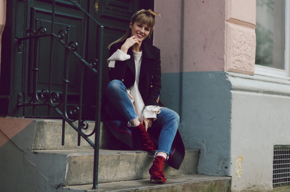 winter coat, sweater, red boots, jeans